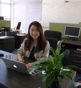 Yixuan all smiles at her new office space , Jembi, Cape Town